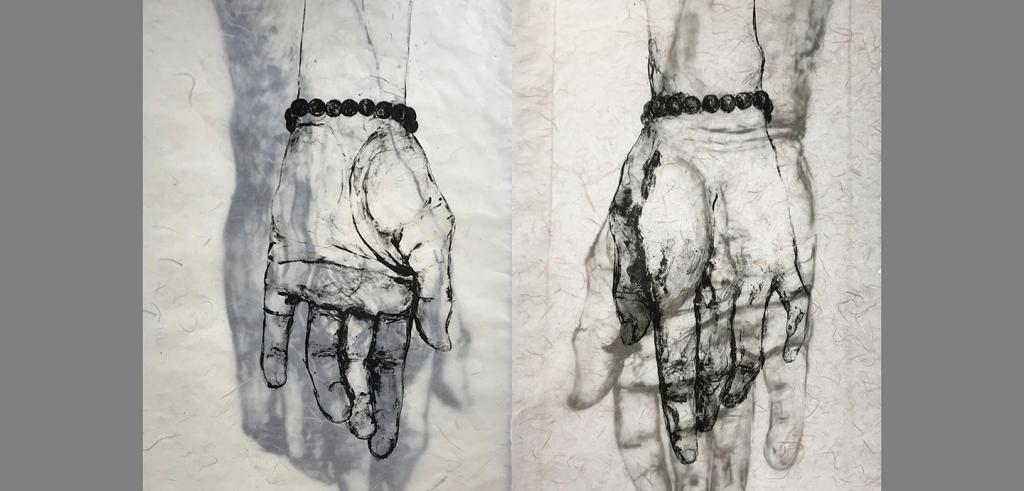 black and white drawing of two hands with black beaded bracelets on the wrists
