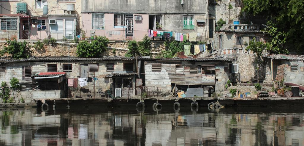 Houses line the banks of the Almendares River, Cuba.