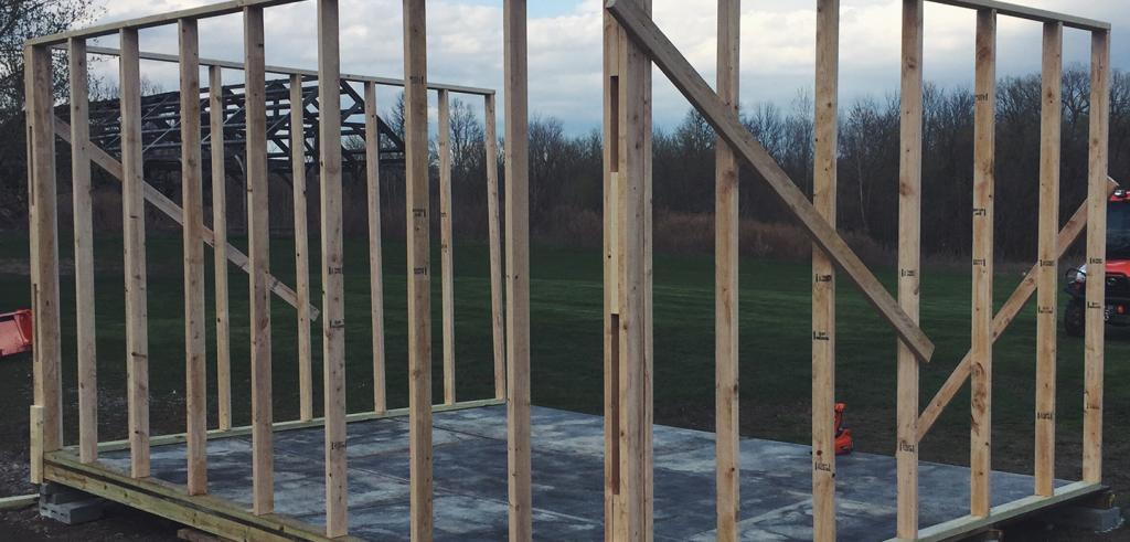 An outside image of a wooden structure being built.