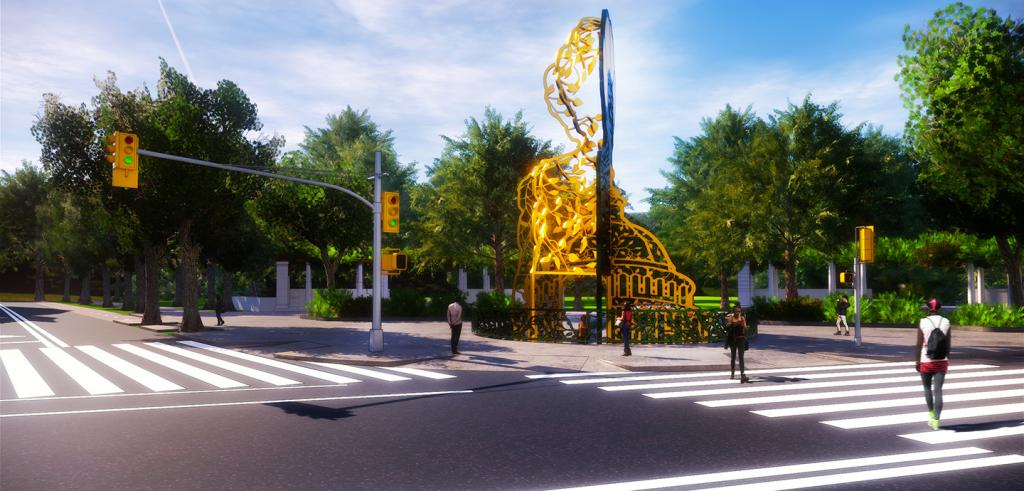 Streett view of an intersection with a gold monument at the entrance of a park.