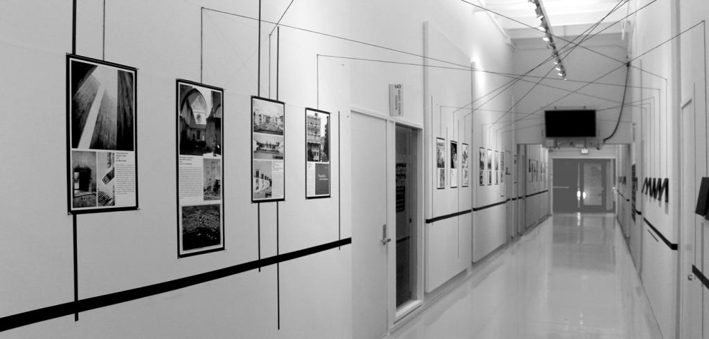 photos mounted in a long hallway