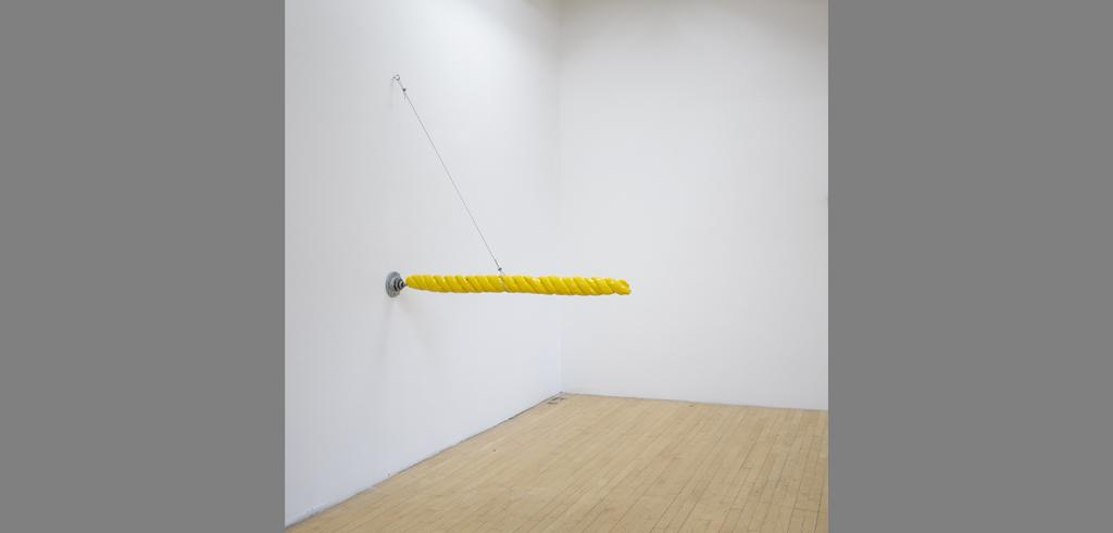 a yellow pole extending from a wall