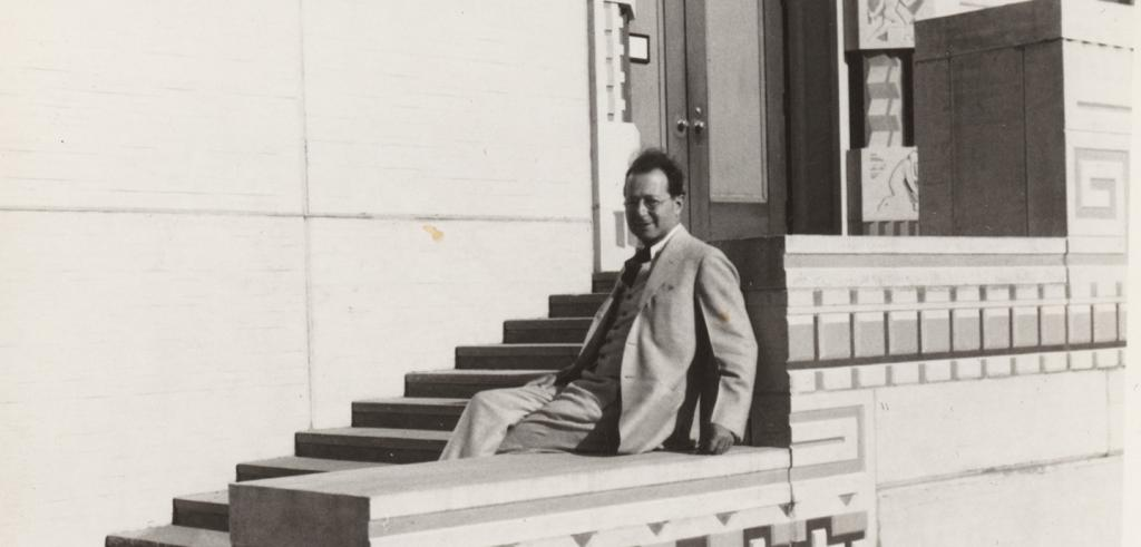man seated on steps of a building