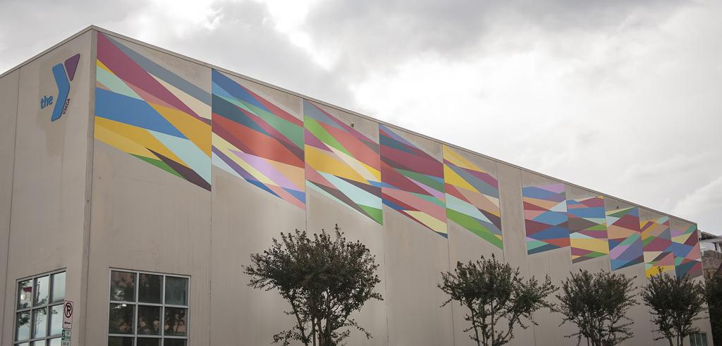series of paintings by Odili Donald Odita on the side of a building
