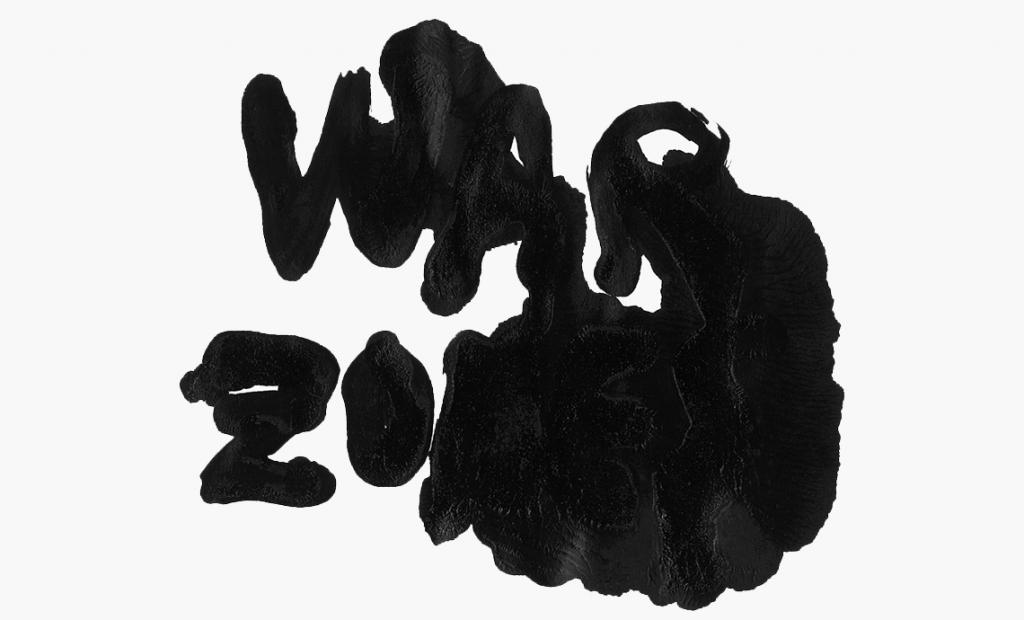 spilled black paint, illegibly spelling the words
