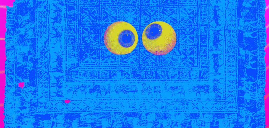 Blue background with a rug pattern with some bright pink colors on the side edges and a set of yellow and blue eyes in the center looking crooked.