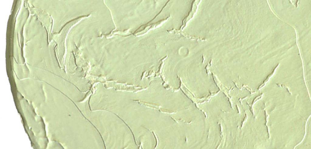 Closeup of a yellow spot on a painting.