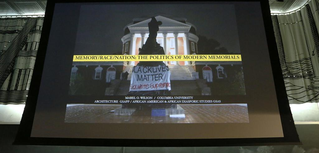 Projection of a Greek Revival building with a monument draped with a banner.