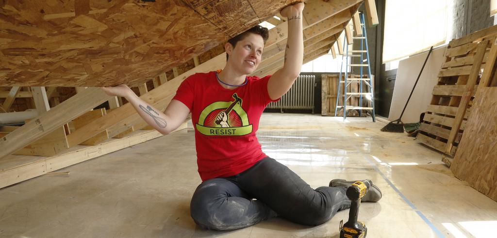 woman building an art installation
