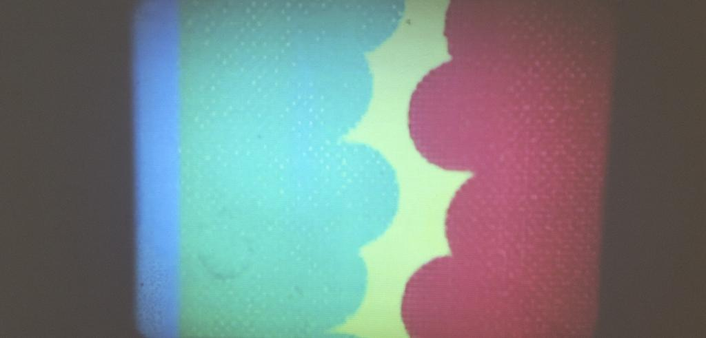 still of an animated film showing blue and red cloud-like forms