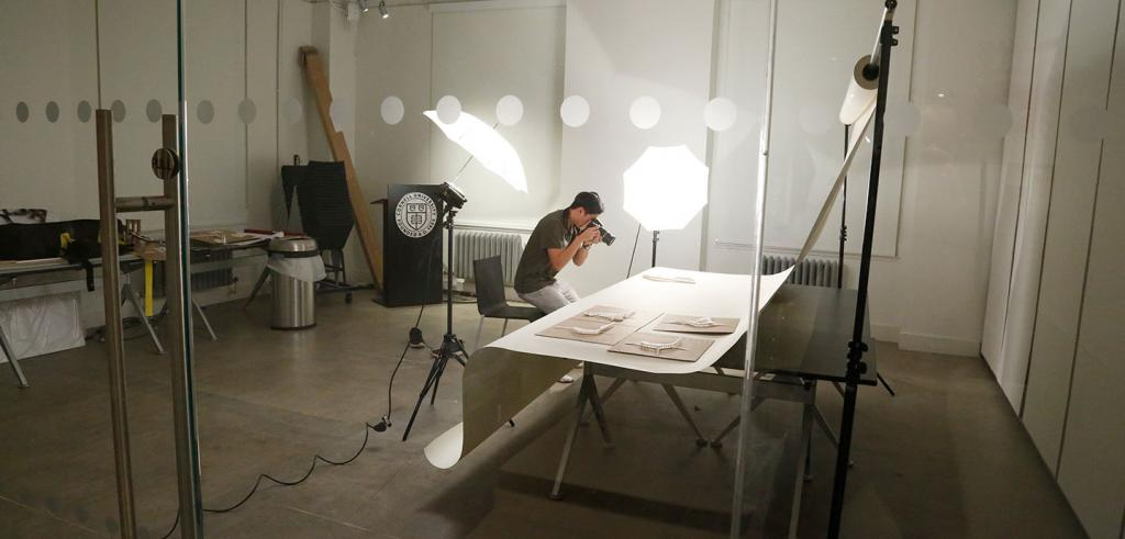 student in a photo studio taking pictures