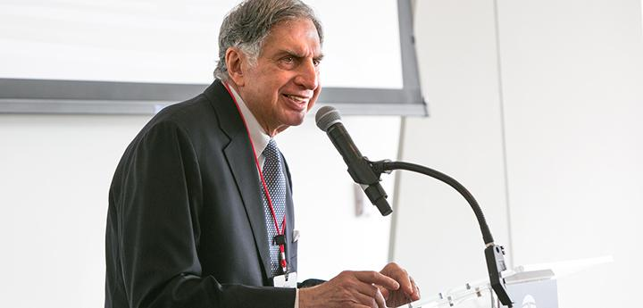 man speaking into a microphone at a podium