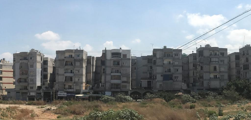 A panoramic view of rows of boxy, six-story concrete apartment buildings. view of many boxy apartment buildings.