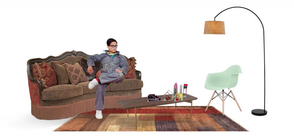 Jimenez Lai of Bureau Spectacular, on a couch in a living room settting.