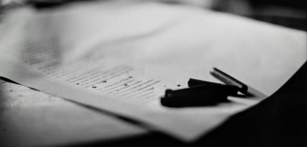 A close up of a piece of paper photographed in black and white.