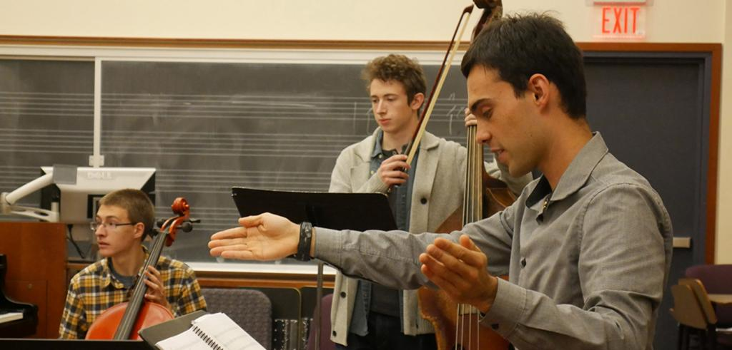 Patrick Braga conducts music during a rehearsal for his opera.