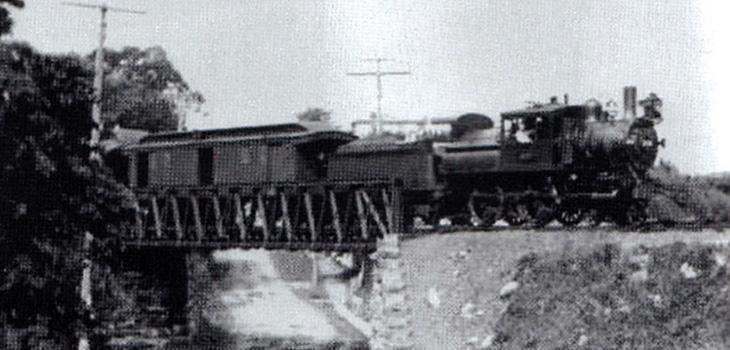 old photograph of train on railway bridge