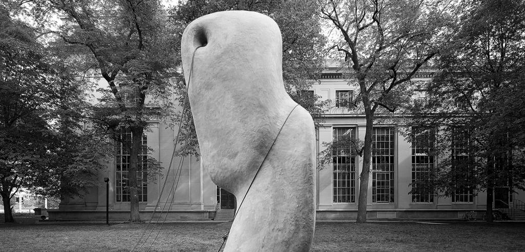 concrete sculpture held in place by chaines