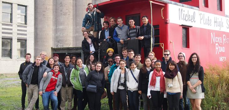 Students posing on a red caboose