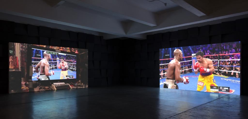 two boxing program projections in a room