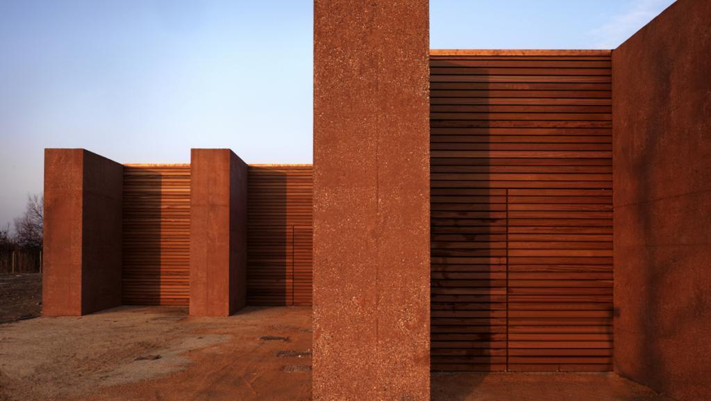 wooden building constructed of slats of reddish wood