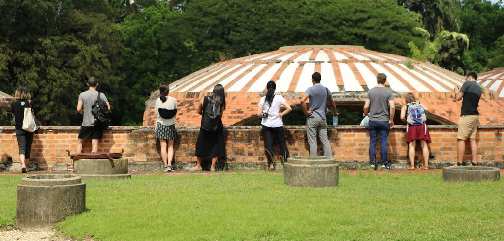 The group at the ruins of El Instituto Superior de Arte in Cuba.