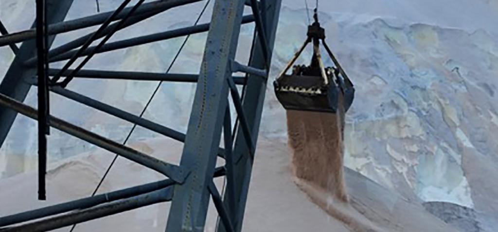 View through crane cab window: transferring salt from ship to shore.