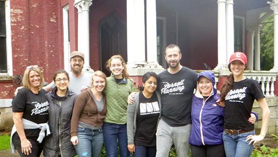 volunteers standing in front of Auburn Castle