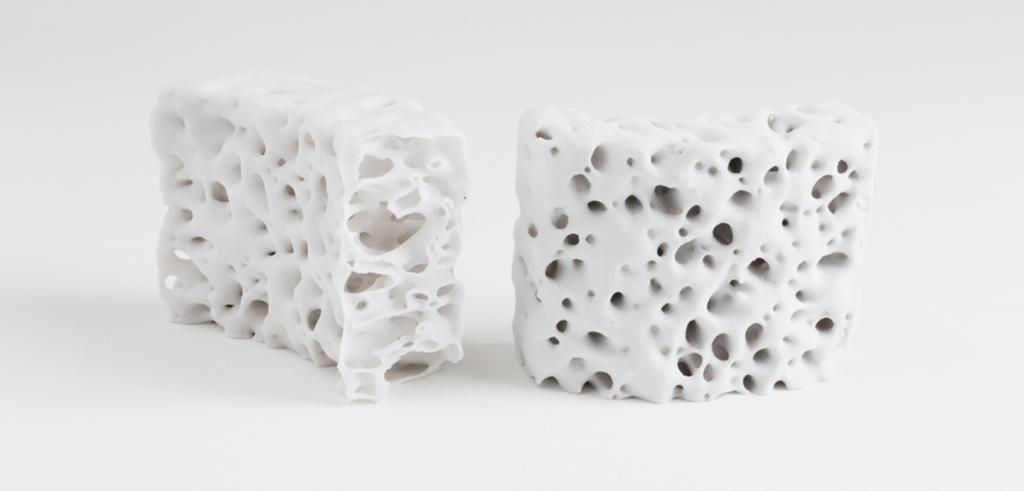 White porous 3d blocks against a white background