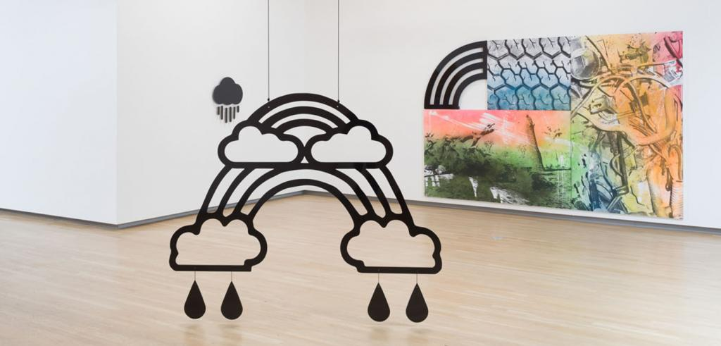art installation with rainbow raincloud sculptures and painting