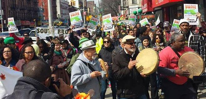 Crowd protesting in South Bronx street