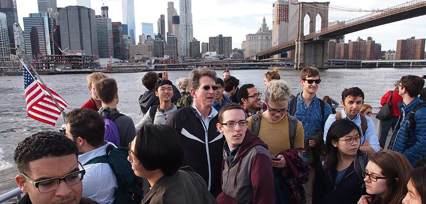 Students on ferry ride to Brooklyn with Brooklyn Bridge in background