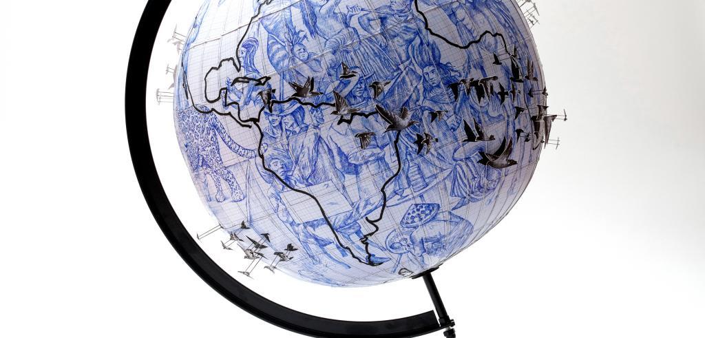 a globe showing migration patterns