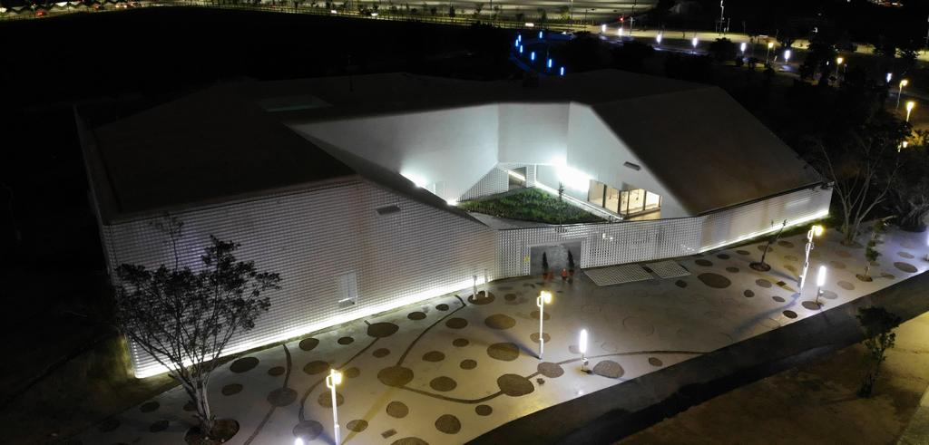 an aerial view of a modern building at night