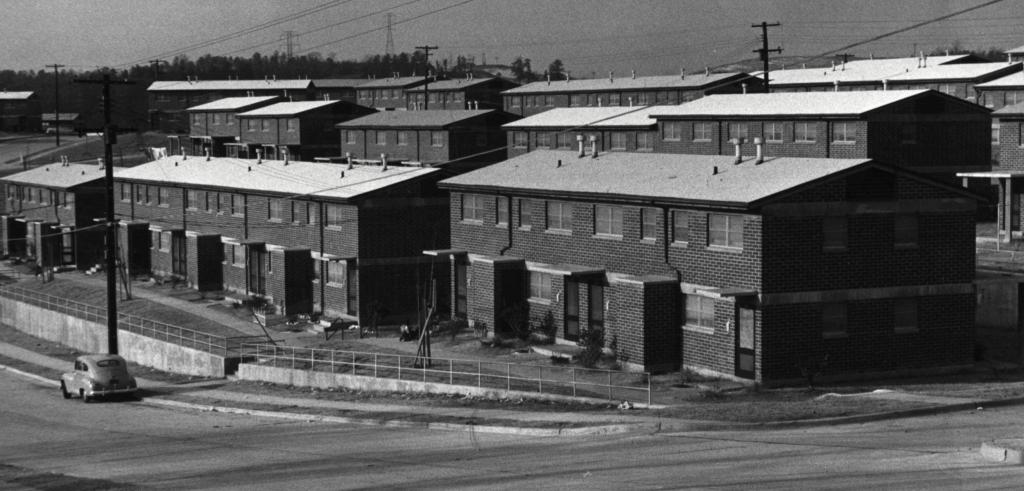 black and white photograph of large public housing units
