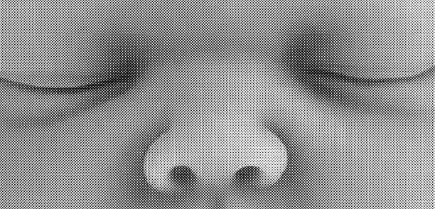 Black and white image of a young child's eyes and nose.