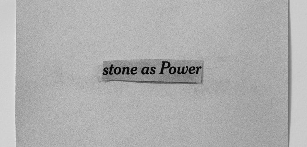 Image of a grey piece of paper with a smaller piece of grey paper on top with the words 'stone as Power'.