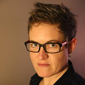 a woman's face wearing glasses