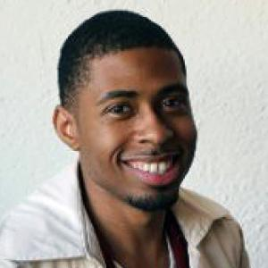 headshot of young man smiling