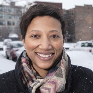 headshot of a woman outside a public housing project in the snow