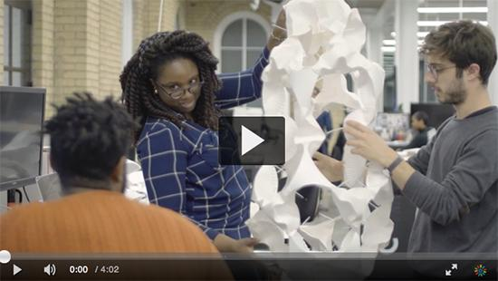 video shot of students with a large white model
