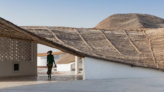 Image of undulating thatched roof and covered breezeway