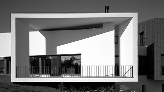 Black and white image of a geometric building