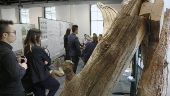 people standing in a room with a log