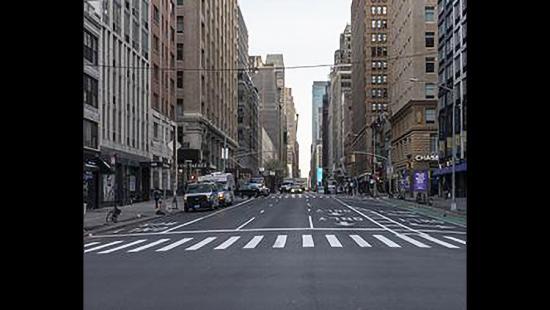 deserted city street viewed between multi-story buildings