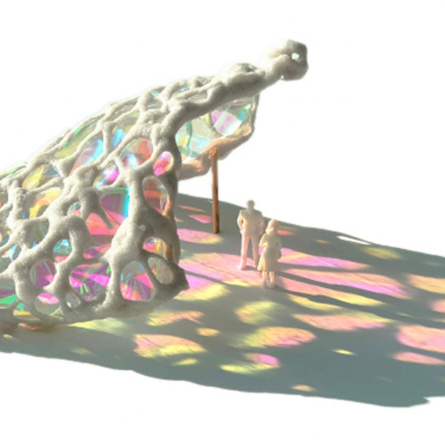 Study model of canopy with colored film emitting shadow.