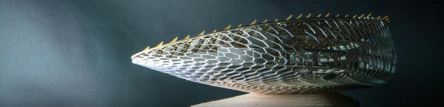 An architectural model consisting of a series of interconnected cell-like structures.
