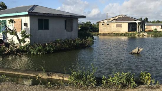 water level at the base of boarded-up buildings