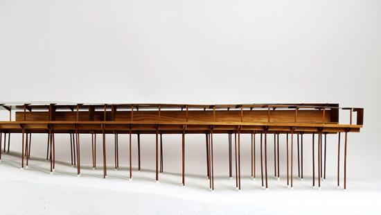 Horizontal wood model on stilts.