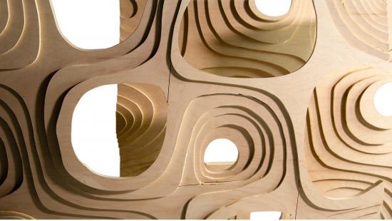 Wood screen with circular openings.